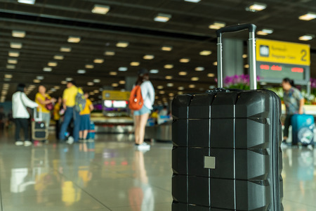 Lost black hardshell carry-on roller luggage left unattended at the baggage reclaim area at airport 写真素材 - 122403636