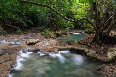Beautiful natural scenic of watercourse from Erawan waterfall in Kanchanaburi, Thailand in Kanchanaburi, Thailand 스톡 콘텐츠