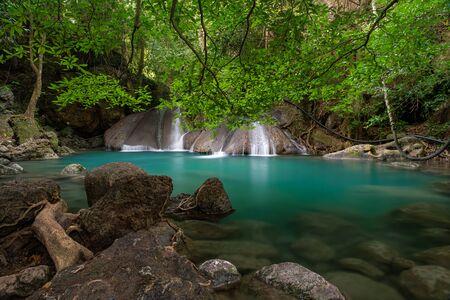 Beautiful natural scenic of Erawan waterfall tier four with emerald green pond named Oak Pee Sua in Kanchanaburi, Thailand 스톡 콘텐츠