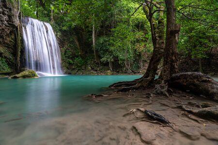 Beautiful natural scenic of Erawan waterfall tier three with emerald green pond named Pah Num Tok in Kanchanaburi, Thailand