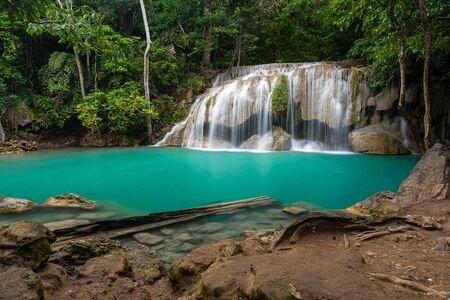 Beautiful natural scenic of Erawan waterfall tier two with emerald green pond named Wang Mutcha in Kanchanaburi, Thailand 스톡 콘텐츠