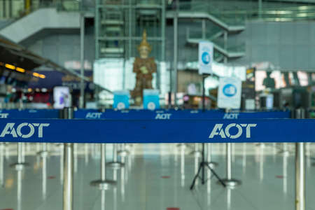 Suvarnabhumi Airport, Bangkok, Thailand - April 4, 2020 : Blue belt from queue pole barrier stands with AOT logo