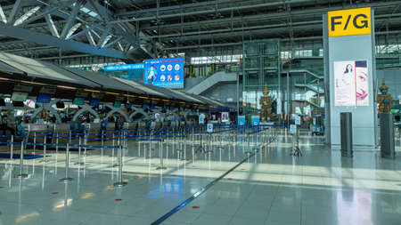 Suvarnabhumi Airport, Bangkok, Thailand - April 4, 2020 : Empty check-in area at departure hall due to Coronavirus or COVID-19 epidemic Editorial