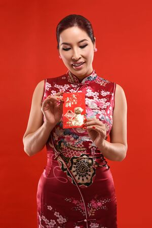 sexy asian woman: Studio shot Beautiful sexy Asian woman cerebrate Lunar New year in Chinese style