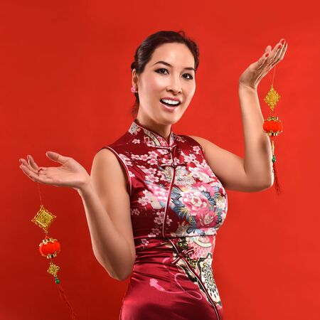 cerebrate: Studio shot Beautiful sexy Asian woman cerebrate Lunar New year in Chinese style