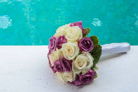 purple roses: wedding bouquet of White and purple roses