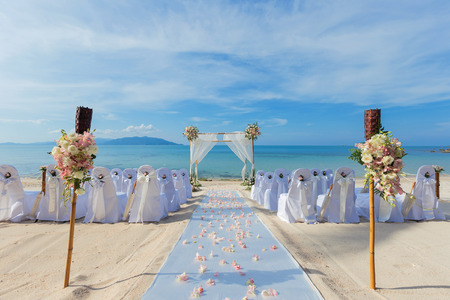 wedding flower setting on the beach
