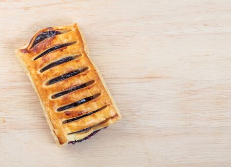 cereza: Puff pastry stuffed  with Blueberry jam on tray wood