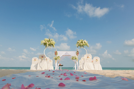 wedding flower setting on the beach