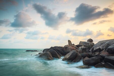 Low shutter speed shooting of a dramatic scenic landscape shot of Grandfather Rock in twilight time, famous tourist attraction on Samui island, Thailand Stok Fotoğraf