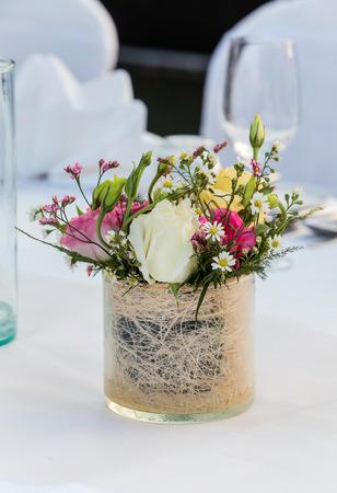 Flower setting on dinner table