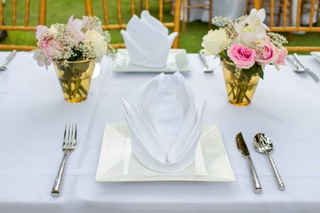 White napkin setting on dinner table