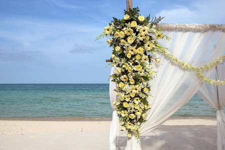 Flower setting on the beach for wedding ceremony