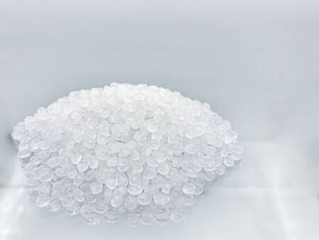 Polypropylene granule close-up background texture.