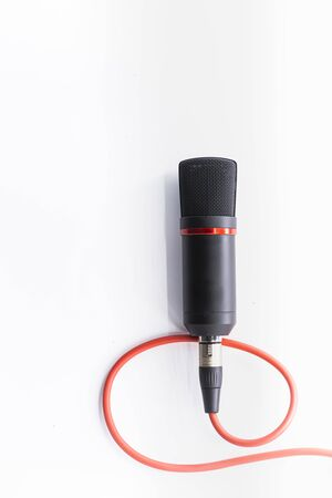 Sound studio. Microphone with cable isolated on white background 版權商用圖片