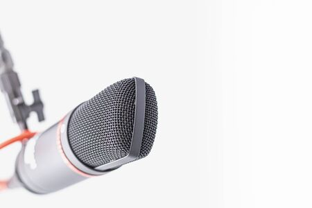 Sound studio. Microphone with cable isolated on white background