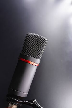Sound studio. Microphone with cable isolated on black background