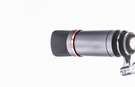 Sound studio. Microphone with cable isolated on bright background
