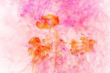 Background water soluble ink .abstract red and pink watercolor soluble in water . Backdrop with copy Фото со стока
