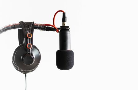 High-quality Microphone and headphones on a white background.