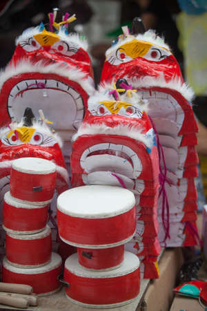 Traditional market sells colorful lanterns with different shapes, lion heads, drums... for the mid-autumn festival. The market is organized at Old Quarter, Hanoi. Archivio Fotografico