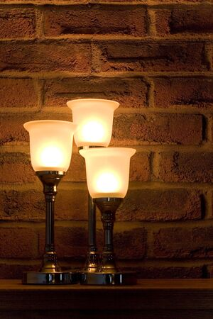 Candles against a brick wall. Imagens