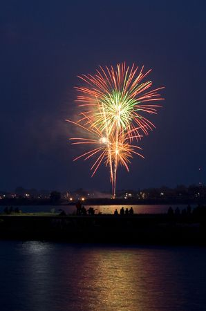 Fireworks on a riverfront celebrate Independence Day. photo