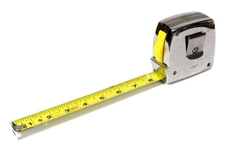 An old tape measure against a white background.