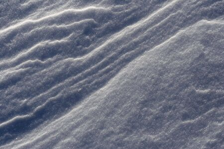 An abstract background close up of a snow drift.