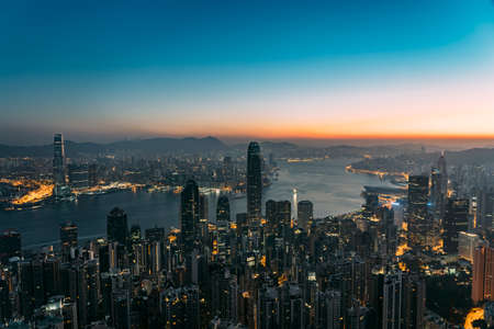City skyline of Hong Kong during sunrise looking into the harbor.