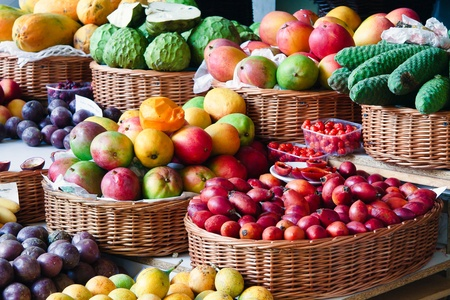 veg: Close-up of a fruit and vegetable stall in Funchal covered market Stock Photo