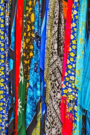 Multicoloured silk scarves on a market stall in Madeira Stock Photo - 8369889