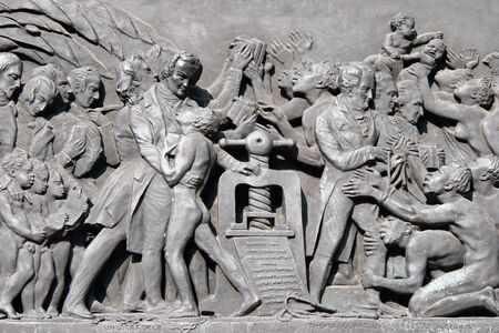 Stone relief depicting Wilberforce and the freedom from slavery Stock Photo