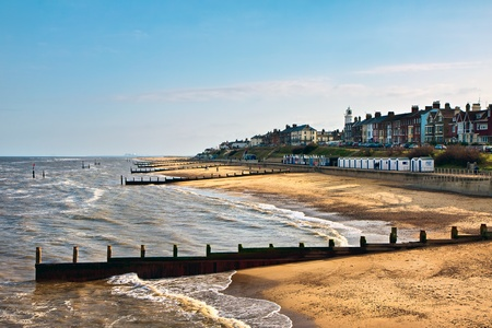 View of Southwold beach bathed in evening sunshine photo