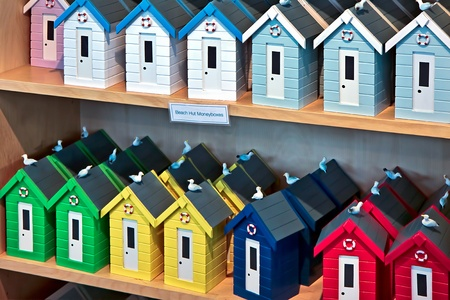 A display of plastic beach hut money boxes photo