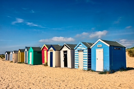 Row of beach huts on the sand at Southwold