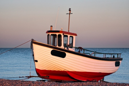 beached: Fishing boat on Dungeness beach Stock Photo