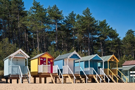 british weather: Beach huts at Wells Next The Sea Stock Photo