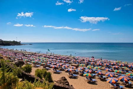 People relaxing on a beach in Lanzarote Spain Stock Photo