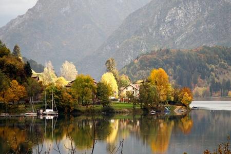 Scenic autumn view over Lago dIdro Italy photo