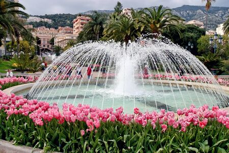 sightseers: View of the fountain in the park at Monte Carlo