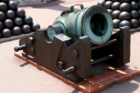 Preserved old cannon and cannon balls at the Palace in Monte Carlo Monaco photo