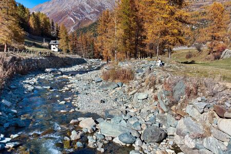 religious habit: Nun reading by river in Cogne Gran Paradiso Park Valle dAosta Italy