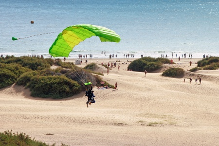 Couple paragliding over Playa del Ingles beach