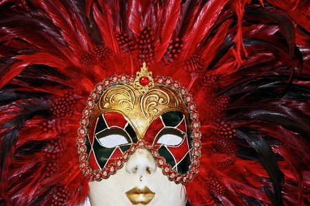 Venetian mask on display in a shop in Venice Italy photo