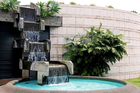 travel features: Modern art man made waterfall and pool Stock Photo
