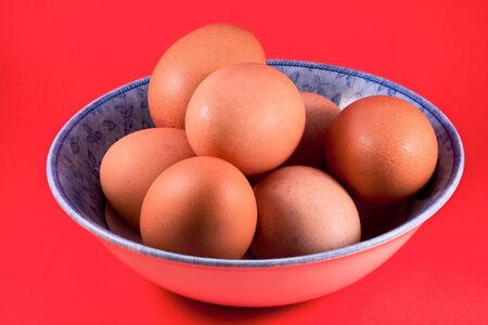 Bowl of brown eggs photo