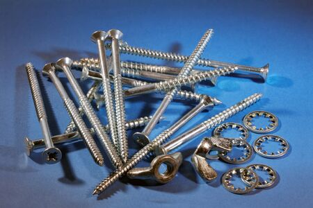 Steel screws, wing nuts and internal tooth lock washers photo