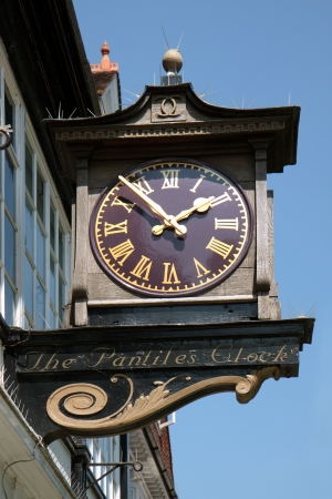 A close-up view of the famous Pantiles clock in Royal Tunbridge Wells