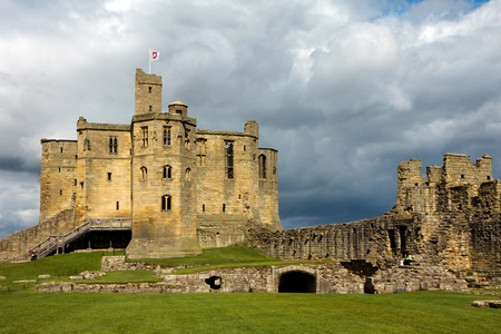 Warkworth Castle under stormy sky